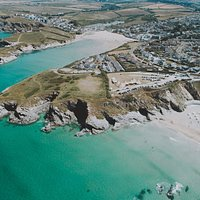 Bird's eye view of Lusty Glaze Beach, a privately-owned cove on the North Cornish coast.
