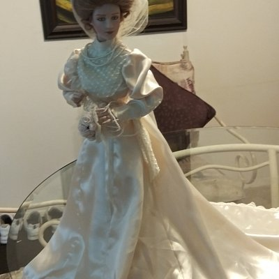 wedding ring is 18carat gold, lovely doll. $200