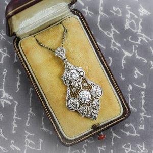 A stunning Edwardian platinum and diamond pendant