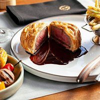 My Wellington: Polish beef tenderloin, puff pastry & mushroom filling. Old wine sauce and spring beans