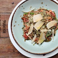 Root Vegetable Bolognese - basil infused spaghetti wiht San Marzano tomato, grana padana, and herb crust - Vegetarian dish
