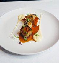 Seared scallops w confit pork belly, brassicas & calvados sauce