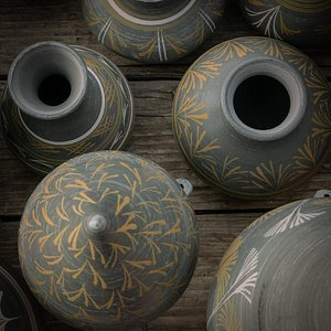 Handmade and hand paint pots fired in the wood kiln.