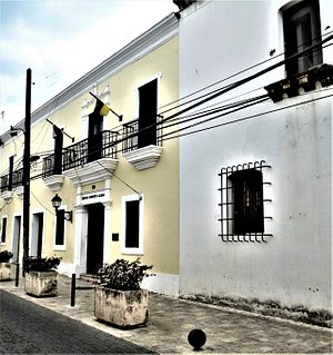 "The yellow facade of the ""Centro Cultural Dominico-Alemán"" at Santo Domingo's Calle Isabel la Católica in the ""Ciudad Colonial""."