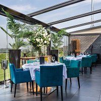 The Terrace  - our most sought after area has floor to ceiling glass windows and has a stunning view across the fields of Brentwood. We can accommodate up to 30 guests in this space and close it off from the main restaurant to make it exclusive.