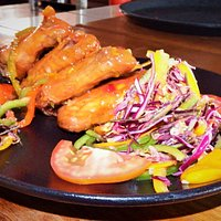 CHICKEN WINGS (4pcs) Succulent Sticky Honey Glazed Chicken Wings tossed in bell peppers.