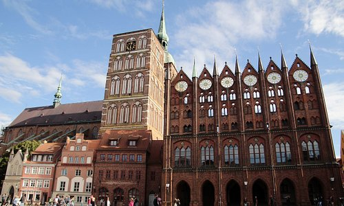 Stralsund, Mecklenburg-Vorpommern, Germany, Alter Markt - southern frontage with Gothic Town Hall and St. Nicholas Church.