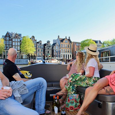 Open boat tour through Amsterdam's canals