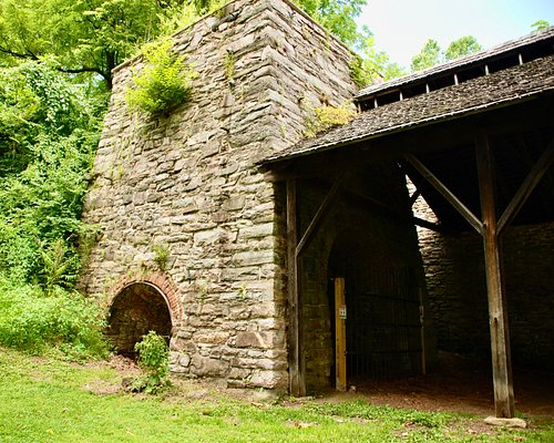 """The stack known as """"Isabella"""" is the focal point of the Catoctin Furnace remains. The 1858 casting shed has been reconstructed next to it.  Photo credit: Andrea Munk"""