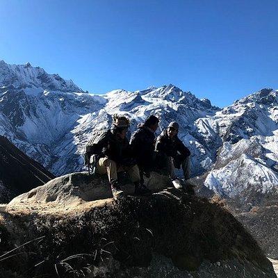 Three Trekking guides on the way back from Tserku-RI 5000m to Kyanjing village. A huge beautiful day.