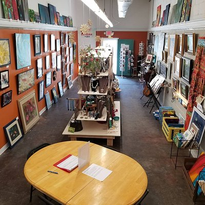 Inside looking towards the front door. Paintings, pottery, jewelry, metal, wire, wood, glass, prints and cards.
