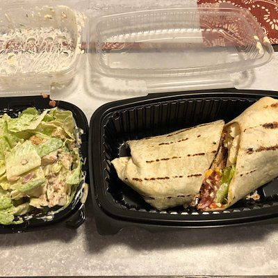 A wrap and Caesar salad take out from overtime