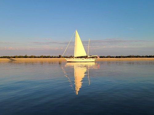 Peacefully sailing along at sunset