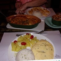 Fish  in maracuja  sauce  with  rice and bata  saute and steak  with  chips and  vegetables
