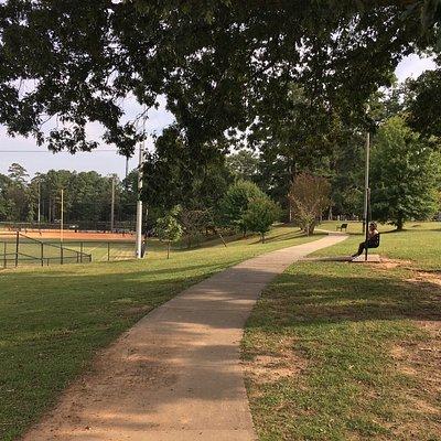 Paved walking path circles the park