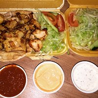 Chicken shish with a extra portion of salad