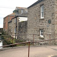 The front of the gallery alongside Newlyn Coombe River, right in the heart of Newlyn, Cornwall.