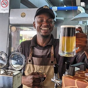 Barman Dennis and his first Twiga Fling (Half Ale - half Stout).