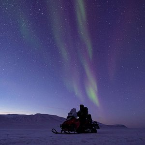 Northern Lights safari by snowmobile