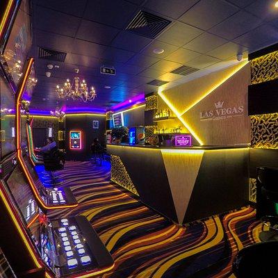 Sală de jocuri Las Vegas Games – Bucureşti, Bulevardul Basarabia – gambling, casino, sloturi, păcănele, jocuri de noroc, ruletă, jackpot-uri, pariuri sportive, cafenea, bar, băuturi din partea casei, tombole, premii cash, distracţie şi multe surprize