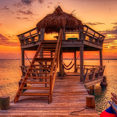 Relax in a hammock at sunset on our beautiful dock