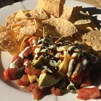 Divots - My favorite lunch order is the Ahi Tuna Poke (cubed sushi grade tuna tossed in a ginger soy sesame sauce, with avocado, cucumber, tomato, house tortilla chips, wasabi aioli drizzle).  Delicious!