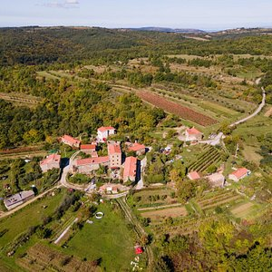 The village of Abitanti from the air and the landscape of the Green Gradin area