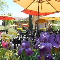 Tuscan-style gardens provide the ideal setting to savor a glass of wine & share a meal.