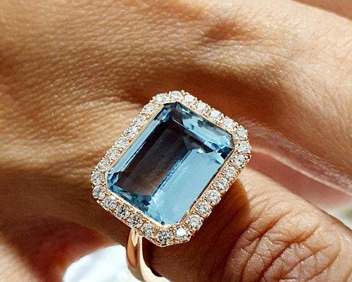 A stunning 4.94ct Santa Maria Aquamarine with diamond halo set in 18ct rose gold.