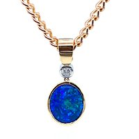 A client's opal was set in this stunning pendent with diamond in 18ct gold.