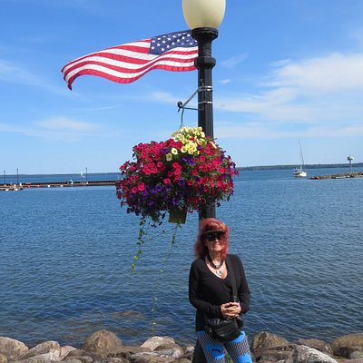 Each of the park's lamp posts was adorned with an American flag and a basket of beautiful blooms