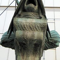 Triton, sitzt auf einen Fisch...