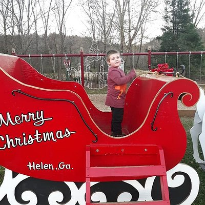 Logan in the Christmas sleigh at the park
