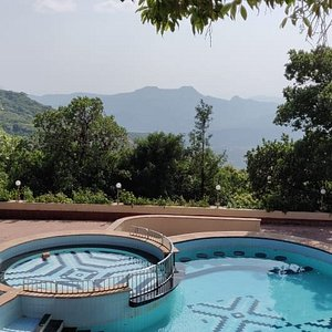 Relax in the pool overlooking the Koyna Valley.