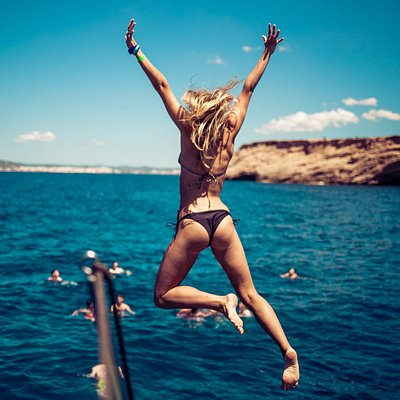 Girl jumping in the water