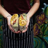 A large Fajita chicken Burrito with added Guacamole