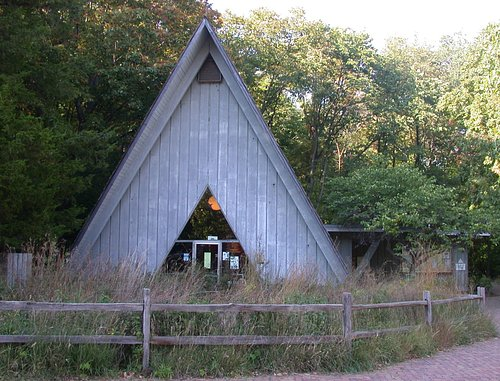 Forest Park Nature Center's characteristic A-Frame building, housing museum, store, and indoor restrooms.