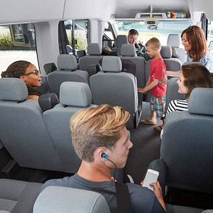 Comfortable, air conditioned tour vans.