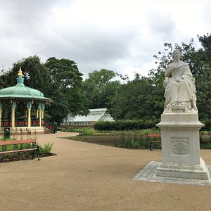 The statue of Queen Victoria, the colourful traditional Victorian style bandstand and conservatory.