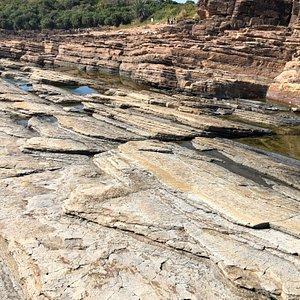 Angular sedimentary layers and rock pools