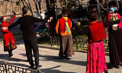Women and men dancing in Green Corridor, Binhe Middle Road