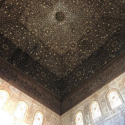 Inside  the Palacio de Comares at the Alhambra. The ceiling in the Hall of Ambassadors is a stunning star-scape that recreates the heavens.