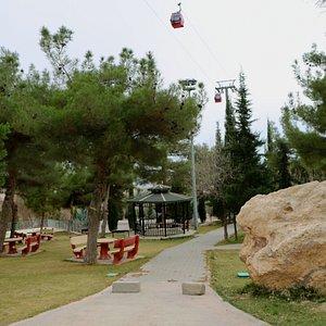 teleferik behind park