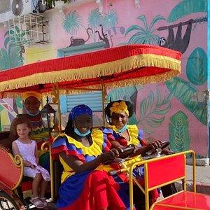 Cartagena's famous Palenquera's enjoying a ride around Getsemani.