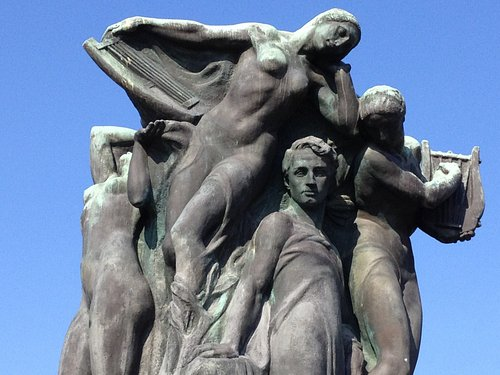 Detail of the statue of Alfredo Catalani, surrounded by the heroines of his operas, located on the city walls of Lucca.