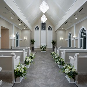 Breathtaking Main Sanctuary- Complete with Multiple Crystal Chandeliers, A Million Dollar Sound System & Soft Florals