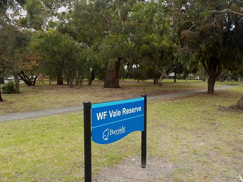 Reserve sign and old trees behind it
