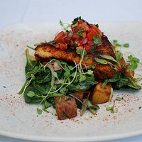 Fresh Catch of the Day, shown blackened and finished with Pico de Gallo.