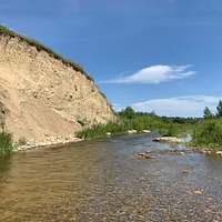 The cliff that overlooks Fish Creek at Hidden Beach (clothing optional area).  There are a few spots deep enough for a dunk, though most is pretty shallow. Perfect for sitting in a lawn chair and keeping your feet wet while you read and relax.