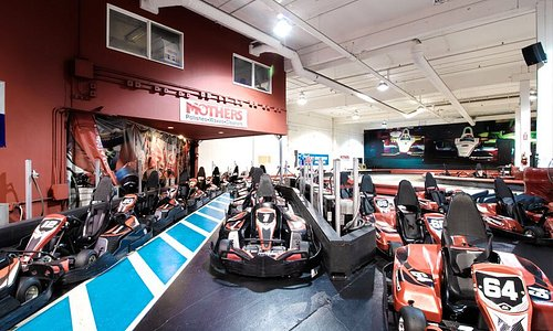 Dozens of fast 100% electric go karts sit in the pits at K1 Speed Seattle in Redmond, WA. The adult karts are capable of speeds that approach 45mph, while our junior karts can reach 25mph!